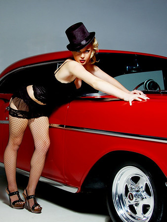 "Emily  looking spectacular in some burlesque styled lingerie posing with a 1957 Chevy. The rear strobe was ""iffy"" and only firing every now and then so the backgroud is a bit dark in this one."