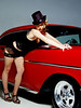 """Emily  looking spectacular in some burlesque styled lingerie posing with a 1957 Chevy. The rear strobe was """"iffy"""" and only firing every now and then so the backgroud is a bit dark in this one."""