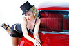 Emily looking spectacular in some burlesque styled lingerie posing with a 1957 Chevy.