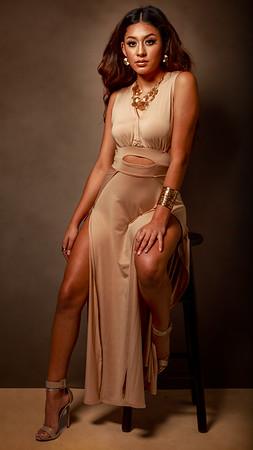 Image of Melody rocking a bronze dress.