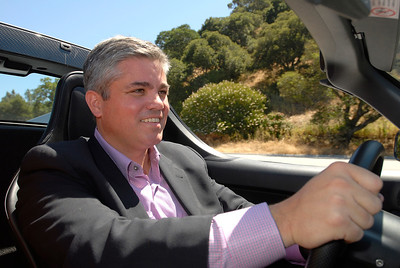 General Counsel of Tesla driving one of their cars.