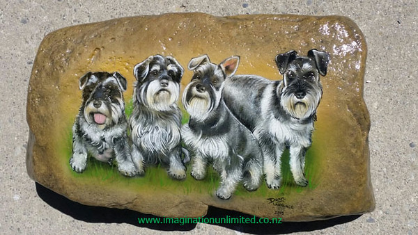 i painted this rock which is about 2 feet wide for a memorial for a ladies four dogs to be placed under a tree..