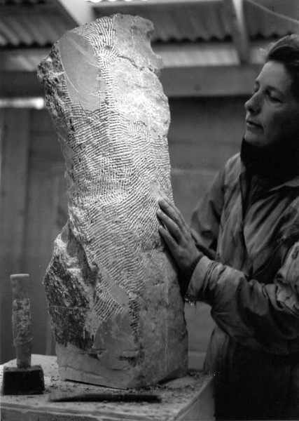 "Ginny Walden carving ""Diana"" from the Goddess Series in black steatite.<br /> The process of carving takes patience and precision and<br /> an ability to ""see"" the complete work within the stone."
