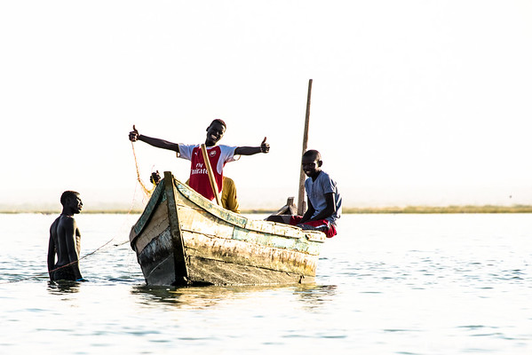 Fishermen off Ferguson Island