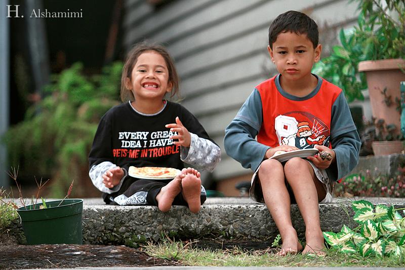 Two Maori kids having their lunch (or breakfast? can't remember) in Rotorua, NZ.