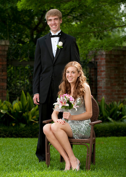 Couples pose at the home of St. John's School Junior Clay Nickens for couples and a group portrait prior to travelling to the Renaissance Hotel for the Junior-Senior Prom.