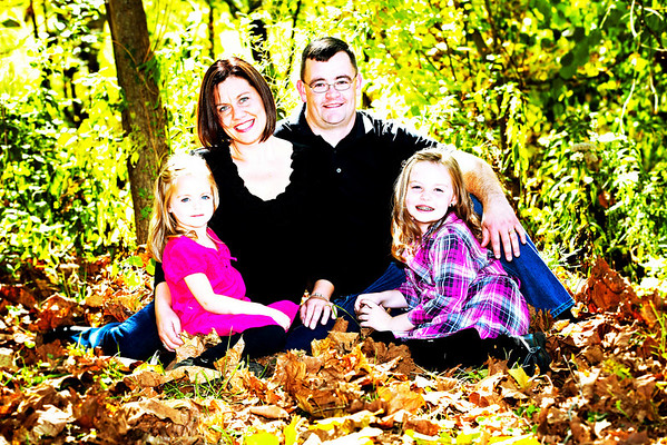 Family portrait sitting with the Stagmyer family at the Sycamore Creek Covered Bridge in Pickerington, Ohio Sunday afternoon October 10, 2010.  (©James D. DeCamp • http://www.JamesDeCamp.com • 614-462-8027)