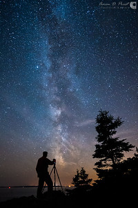 Doug Jackson shoots the Milky Way on September 28, 2014, 8:22 PM at a night sky photography workshop I taught with Vincent Lawrence of Acadia Images Photography Workshops and Matt Pollock at Hunter's Head in Acadia National Park, Maine. We have a couple openings left at this weekend's workshop, May 15-18, if you are interested: www.acadiaimages.com   On this date, in the fall, the Milky Way was 213.5° southwest on the compass dial, with the galactic core becoming visible through nautical twilight, clearest by 7:56 PM, and setting below the ocean's horizon at 9:41 PM. The bright star to the left of the Milky Way is Altair, one of the three stars of the summer triangle.   Nikon D700, Nikon 14-24mm f/2.8, & Promote Control @ 14mm, f/2.8, ISO 4000, 30 seconds, and 3429°K. Edited with Lightroom, dark frame subtraction via PixelFixer.