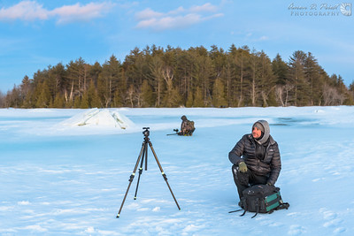 Colin Chase and Garrett Evans shoot some ice formations on River Pond along the Golden Road at sunset, February 24, 2018, 17:39.