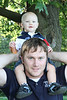 Hang on Braydan.  Braydan on his Dad's shoulders.