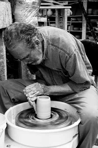 Gino Parisi spends several days a week creating pottery objects at Glen Echo.