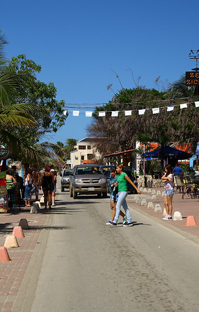 IMG#4195 Tourist teens crosss the street on the island of Bonaire