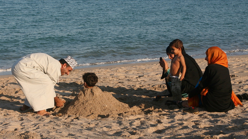 On Christmas day, we stopped at a beach in a local suburb - this father was burying his son as the family looked on.