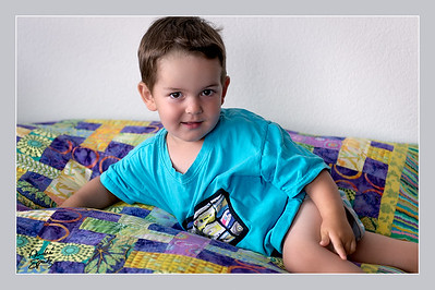 Philippe posing on the living room quilt
