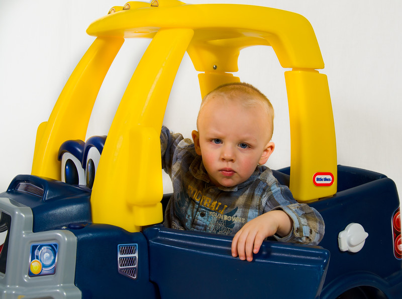 photo of child in blue car