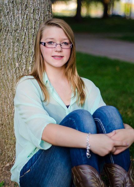 photo of girl sitting on tree