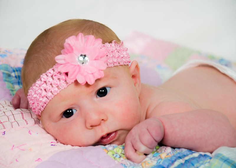 Newborn Photo with pink bow