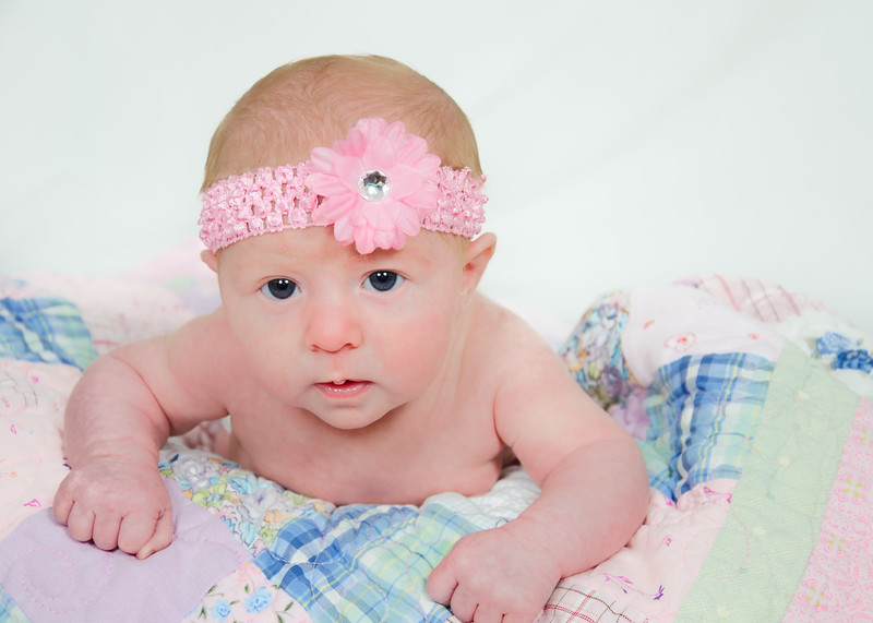 Newborn Photo with pink bow head up