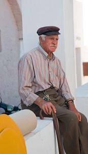 Old man relaxing in Oia Village, Santorini