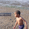 Jhkari, age 3 trying to cool off at Wollaston Beach after 3 straight days of temps in the 90s.