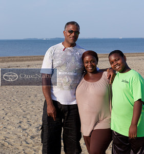 Dwane Hampton, Juanita Yancey and son Jackson Yancey enjoying themselves at Wollaston Beach as part of Dwane's recuperation from gastric surgery.