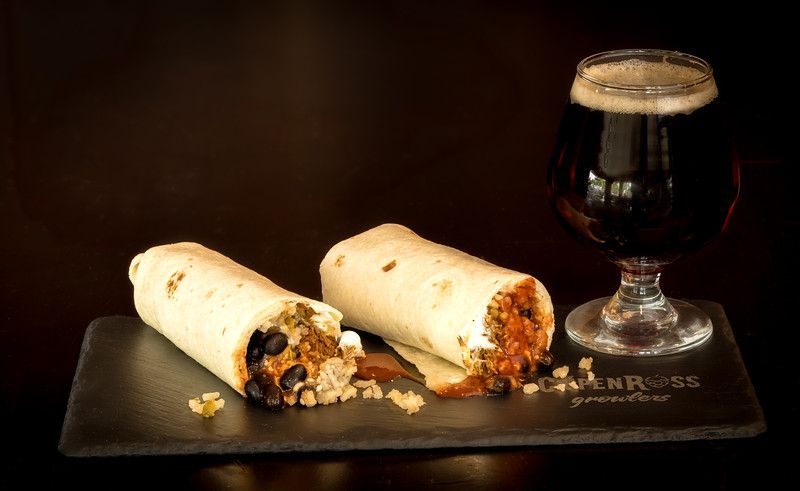 Burrito and beer on slate