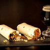 Burrito and beer on slate