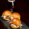 Lunch is severed pulled pork sliders on a slate plate with a beer