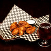 Basket of Chick Wings and a beer ready to eat