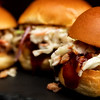 Macro view of fresh made pork sliders in a restaurant