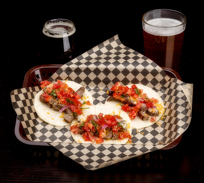 Three little tacos and two glasses of beer make one lunch