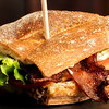 Club sandwich with thick pieces of bacon and lettuce