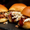 Close up of three perfectly built Pulled Pork Sliders
