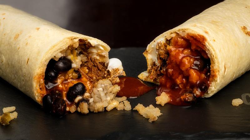 Close up of a burrito cut in half