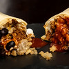 Close up of a burrito cut in half