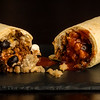 Two burrito half's spilling onto the plate