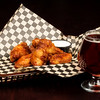Chicken Wing basket with dipping sauce and a cold beer