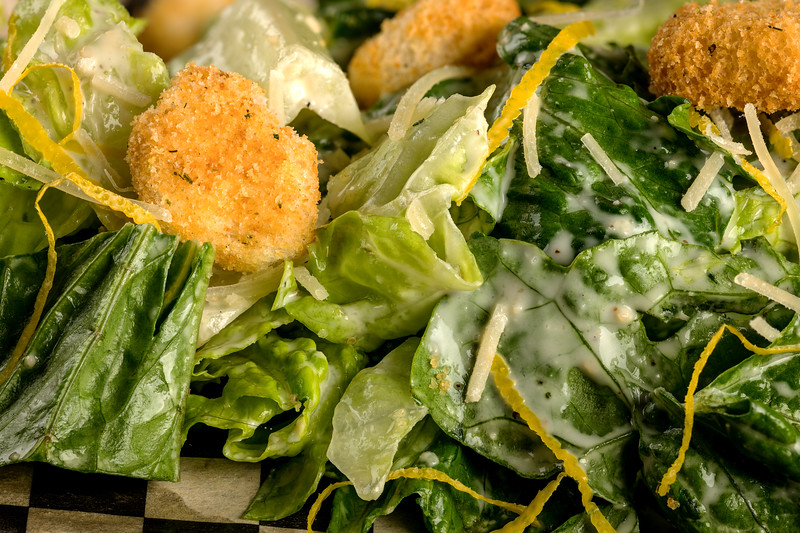 Caesar salad close up with lettuce and croutons