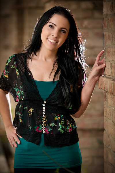 2 speedlights, one camera left thru umbrella, one camera right behind model and column to seperate model from background.