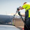 Mechanic fills a plane with fuel preparing for flight