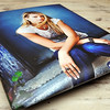 Float Wrap Sample View 01<br /> ----------------------------------------------------------<br /> Float wraps are wonderful for families who enjoy a modern look as your images will appear to be floating on the wall!  Float wraps are created by laminating your image for protection then padding and wrapping it around masonite with a black gatorboard block on the back that allows the float wrap to extend out from the wall.  Like a gallery wrapped canvas, your float wrap will arrive ready to hang.