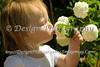 Ella blowing on flowers @ Grandma's House