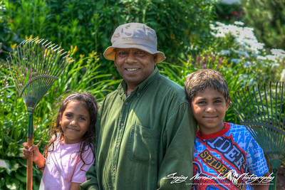 Grampy Narasimhalu gardening with Kethan and Vasantha, Charlottetown, Prince Edward Island, July 30, 2004