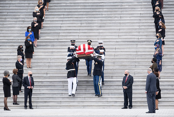 Sept. 25, 2020 - Washington--The body of Ruth Bader Ginsburg is carried down the steps of the Capitol, flanked by the women of Congress.