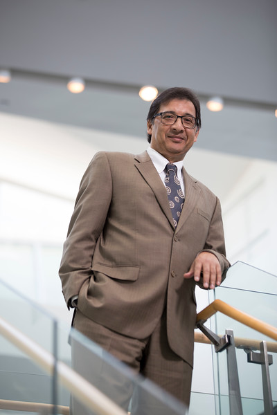 Dr. Nilanjan Sen, Dean of the School of Business, poses for a portrait at The Massry Center for Business at the University at Albany on Thursday, May 24, 2018. (photo by Patrick Dodson / University at Albany)