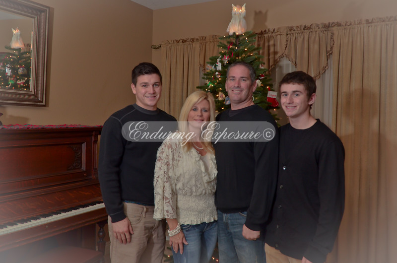 The whole family standing by the tree - Light vignette