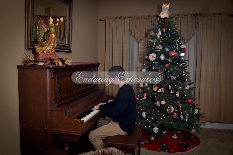 Logan playing the piano