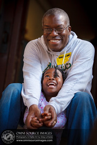 Candid Family Portrait of young girl and her daddy sharing a moment together.