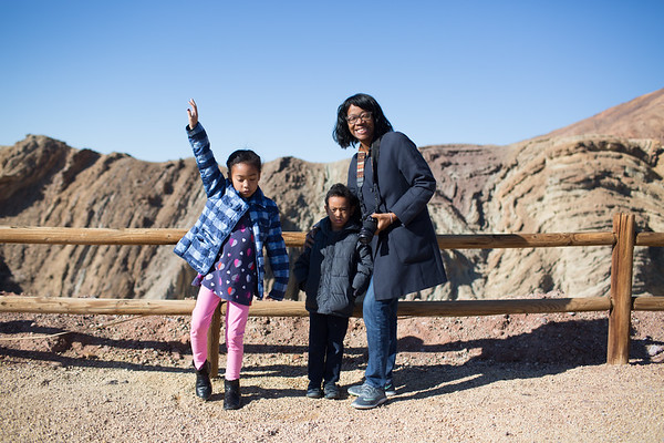Calico Ghost town.   Standing in front of the deep hole behind them.