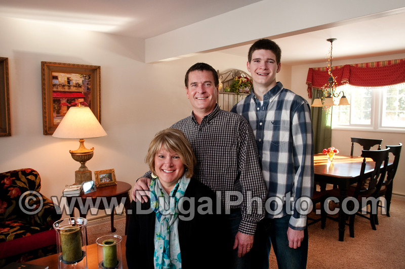 Family portraits for Jim Hess, Jaqua Realtors marketing brochure.  Tammy and Dennis Kohler and son Alex, in their Arcadia neighborhood home.  Copyright Anthony Dugal Photography, Kalamazoo, Michigan, USA, (269) 349-6428.